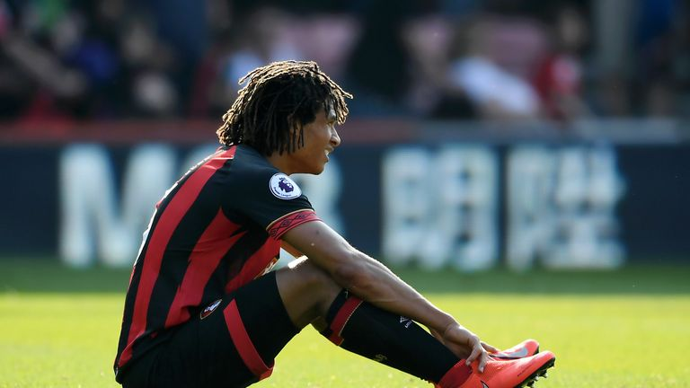 Bournemouth's Nathan Ake sits on the floor following their defeat to Fulham.