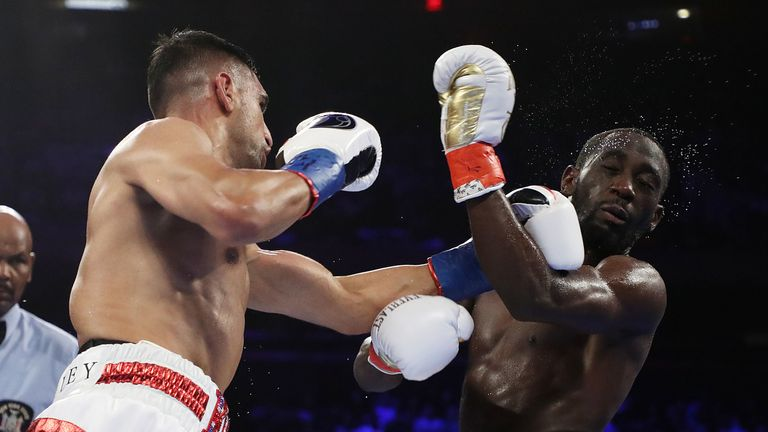Amir Khan catches Terence Crawford with a left hook