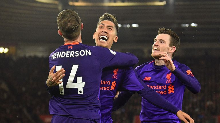 Liverpool players celebrate the victory against Southampton