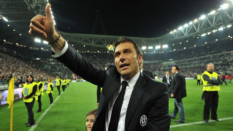 Juventus head coach Antonio Conte celebrates after beating Atalanta BC 1-0 to win the Serie A Championships at the end of the Serie A match between Juventus and Atalanta BC at Juventus Arena on May 5, 2014 in Turin, Italy.