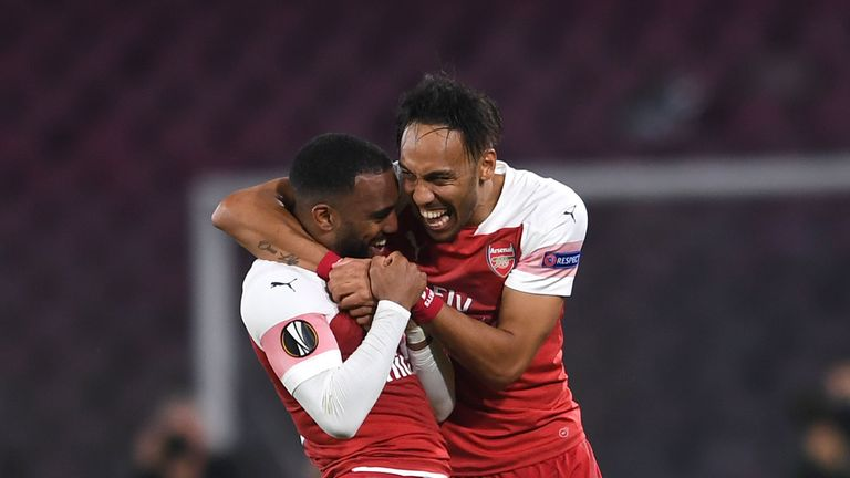 NAPLES, ITALY - APRIL 18: Alexandre Lacazette celebrates scoring a goal for Arsenal with Pierre-Emerick Aubameyang during the UEFA Europa League Quarter Final Second Leg match between S.S.C. Napoli and Arsenal at Stadio San Paolo on April 18, 2019 in Naples, Italy. (Photo by David Price/Arsenal FC via Getty Images)