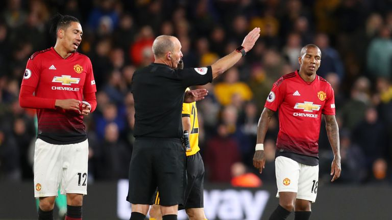 Ashley Young is sent off by Mike Dean