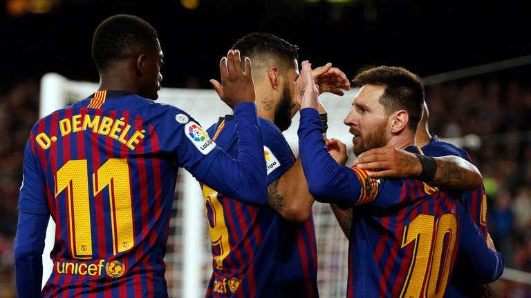 Barcelona players celebrate a goal inside the Nou Camp