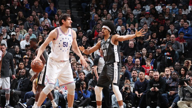Boban Marjanovic #51 of the Philadelphia 76ers handles the ball against Jarrett Allen #31 of the Brooklyn Nets during Game Four of Round One of the 2019 NBA Playoffs on April 20, 2019 at Barclays Center in Brooklyn, New York.