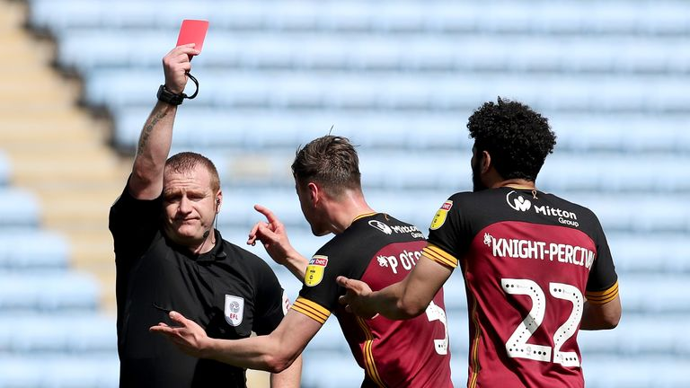Bradford City's Nathaniel Knight-Percival (right) is given a red card