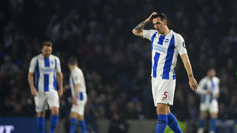 Lewis Dunk of Brighton & Hove Albion cuts a dejected figure during the Premier League match between Brighton & Hove Albion and Cardiff City