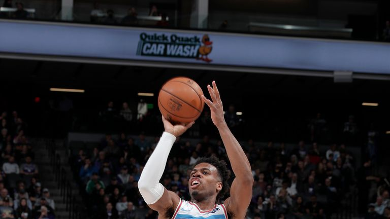Buddy Hield #24 of the Sacramento Kings shoots three point basket against the Cleveland Cavaliers on April 4, 2019 at Golden 1 Center in Sacramento, California.