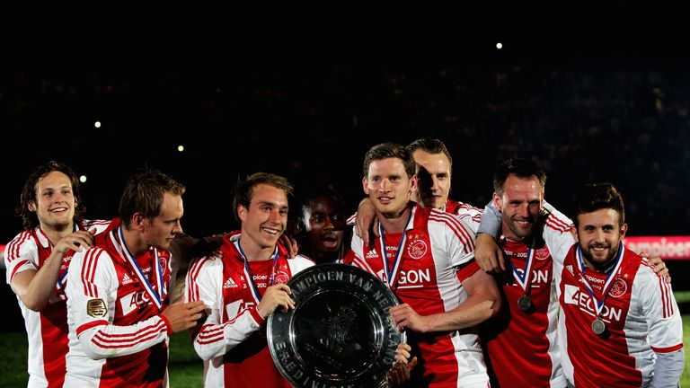Ajax players Christian Eriksen, Enoh Eyong and Jan Vertonghen are among those celebrating the club's Eredivisie win in May 2012