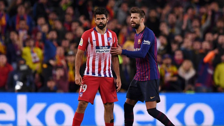 Barcelona defender Gerard Pique attempts to cool Costa down after his sending off
