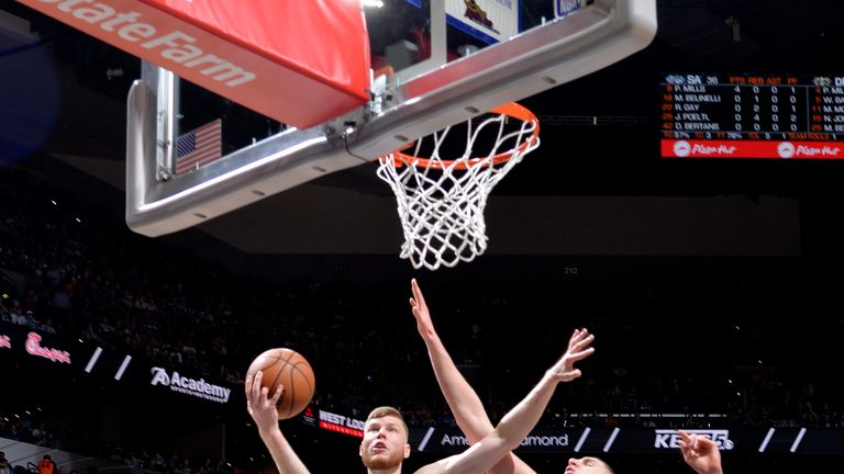Davis Bertans #42 of the San Antonio Spurs shoots the ball against the Denver Nuggets during Game Four of Round One of the 2019 NBA Playoffs on April 20, 2019 at the AT&T Center in San Antonio, Texas.