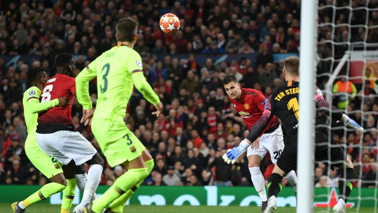 Diogo Dalot heads his glorious chance wide of the Barcelona goal
