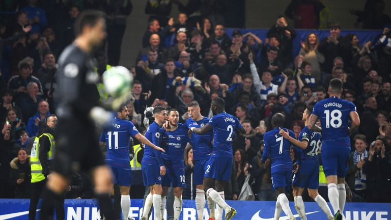 Hazard is congratulated by his team-mates after scoring his second goal