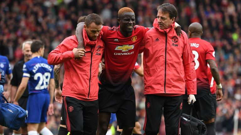 Manchester United's Eric Bailly leaves the pitch after picking up an injury