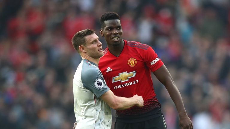 James Milner shakes hands with Paul Pogba
