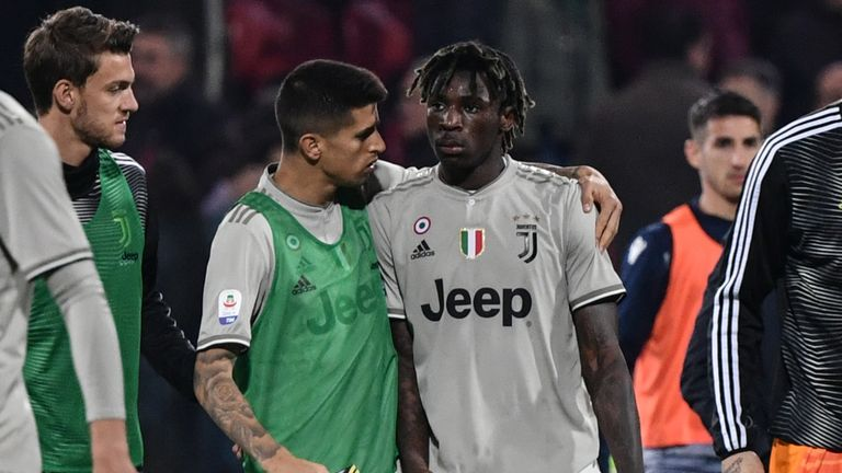 Joao Cancelo comforts Moise Kean after he was racially abused during Juventus' game at Cagliari