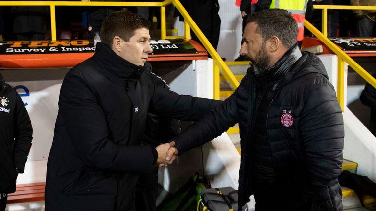 Rangers manager Steven Gerrard shakes hands with Aberdeen manager Derek McInnes