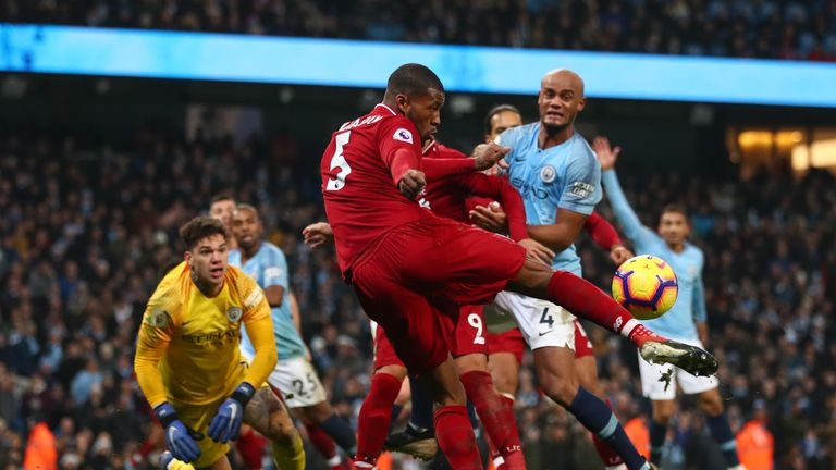 Georginio Wijnaldum of Liverpool clears the ball during the Premier League match between Manchester City and Liverpool