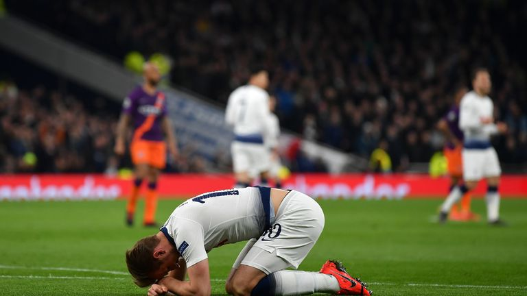 Tottenham's Harry Kane goes down injured during the Champions League clash against Manchester City.