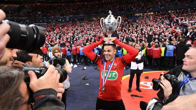 Rennes forward Hatem Ben Arfa celebrates with the trophy