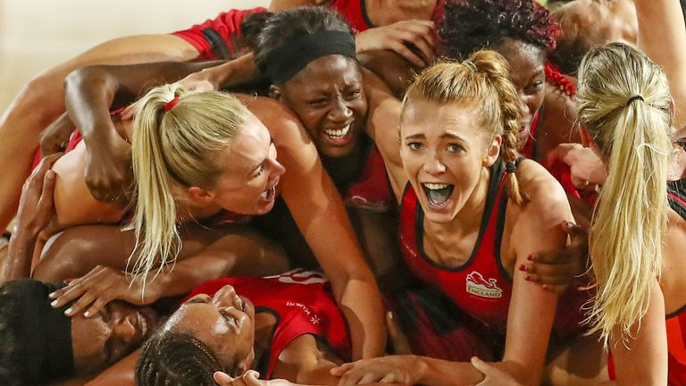 Helen Housby and England celebrate winning the netball gold medal match