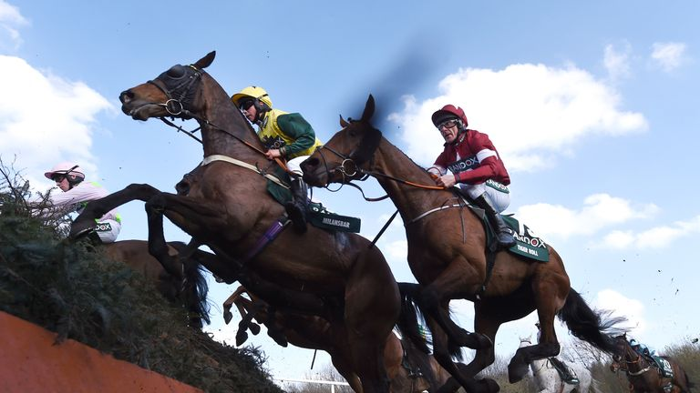 LIVERPOOL, ENGLAND - APRIL 14: Milansbar ridden by Bryony Frost jumps Canal Turn ahead of eventual race winner Tiger Roll ridden by Davy Russell during the 2018 Randox Health Grand National at Aintree Racecourse on April 14, 2018 in Liverpool, England. (Photo by Laurence Griffiths/Getty Images)