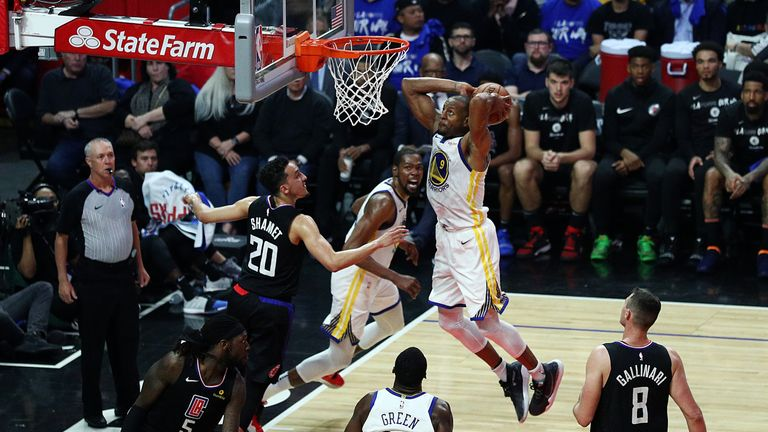 Andre Iguodala of the Golden State Warriors dunks the ball against Landry Shamet #20 of the Los Angeles Clippers
