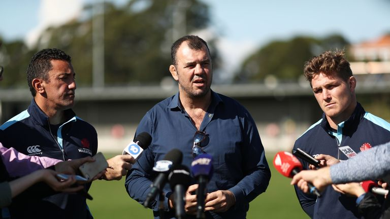Waratahs coach Daryl Gibson (L), Wallabies coach Michael Cheika (C) and Waratahs captain Michael Hooper (R) spoke to reporters about Israel Folau