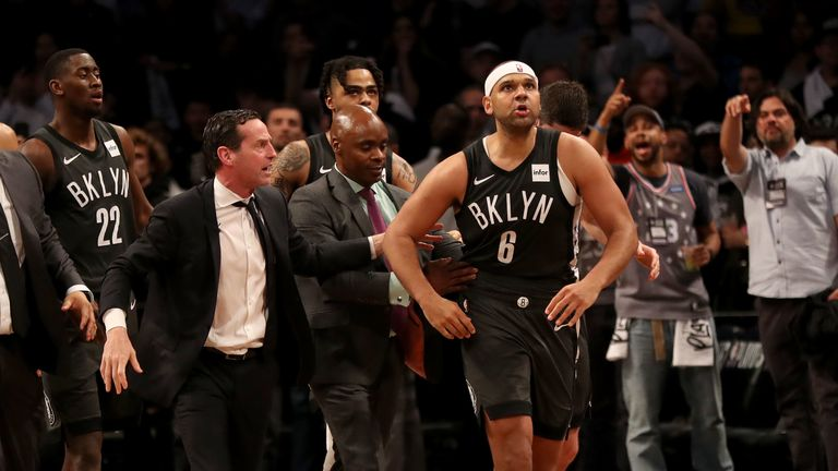 Head coach Kenny Atkinson of the Brooklyn Nets walks with Jared Dudley #6 after a scuffle following a foul by Joel Embiid #21 of the Philadelphia 76ers in the third quarter at Barclays Center on April 20, 2019 in the Brooklyn borough of New York City.The Philadelphia 76ers defeated the Brooklyn Nets 112-108.