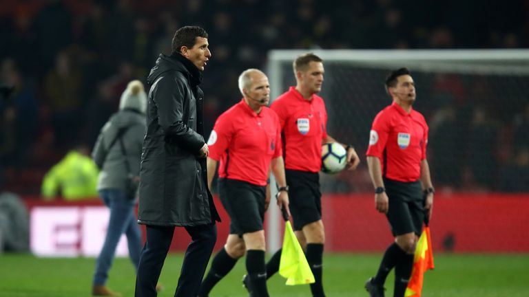 Javi Gracia, Manager of Watford makes his way off the pitch alongside Referee, Craig Pawson and his assistants during the Premier League match between Watford FC and Arsenal FC at Vicarage Road on April 15, 2019 in Watford, United Kingdom