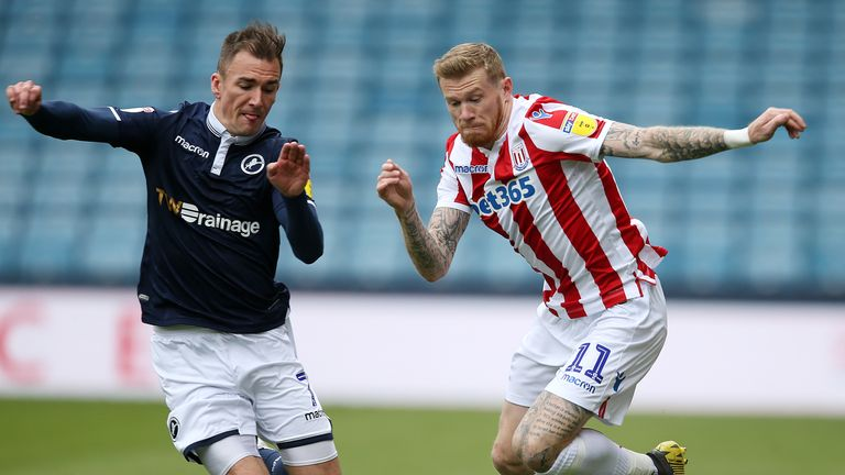 Millwall's Jed Wallace and Stoke City's James McClean battle for the ball