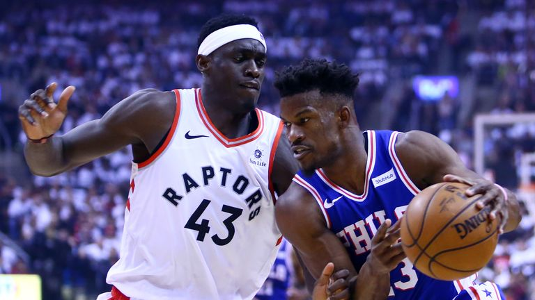 Jimmy Butler #23 of the Philadelphia 76ers dribbles the ball as Pascal Siakam #43 of the Toronto Raptors defends during Game One of the second round of the 2019 NBA Playoffs at Scotiabank Arena on April 27, 2019 in Toronto, Canada