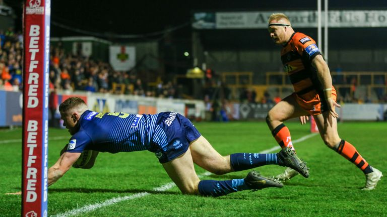 Joe Burgess scores a try during a period of dominance for Wigan in the first half