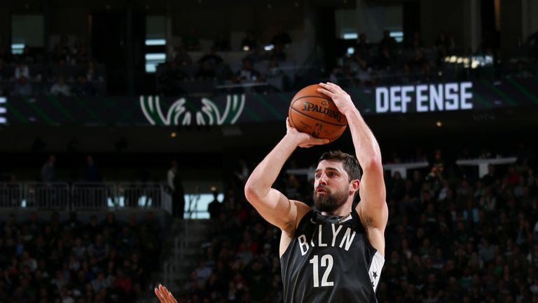 Joe Harris #12 of the Brooklyn Nets shoots a three point basket against the Milwaukee Bucks on April 6, 2019 at the Fiserv Forum Center in Milwaukee, Wisconsin.