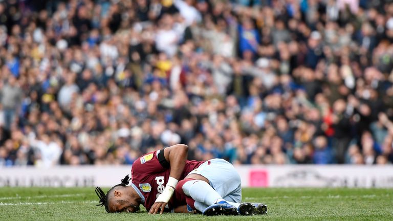 Jonathan Kodjia lay on the ground injured as Leeds controversially continued to play on