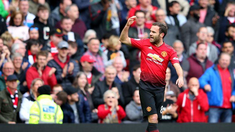 Juan Mata celebrates scoring for Manchester United against Chelsea