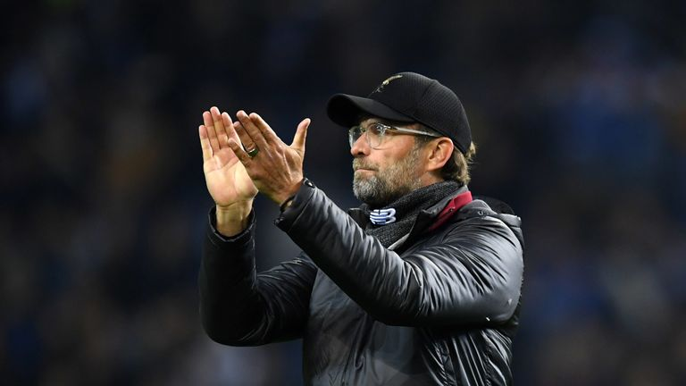 Jurgen Klopp, Manager of Liverpool shows appreciation to the fans after the UEFA Champions League Quarter Final second leg match between Porto and Liverpool at Estadio do Dragao on April 17, 2019 in Porto, Portugal.