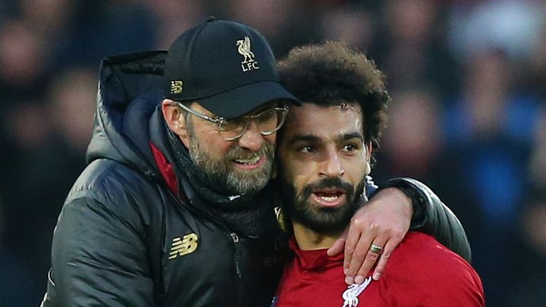 Jurgen Klopp, Manager of Liverpool celebrates victory with Mohamed Salah of Liverpool after the Premier League match between Liverpool FC and AFC Bournemouth at Anfield on February 9, 2019 in Liverpool, United Kingdom.