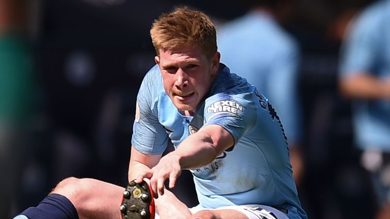 Kevin De Bruyne receives treatment on the pitch after going down injured