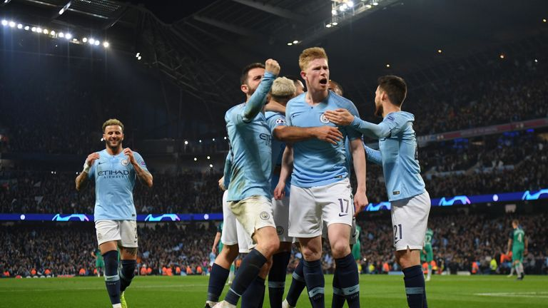 Manchester City celebrate their fourth goal against Tottenham in Champions League quarter-final second leg