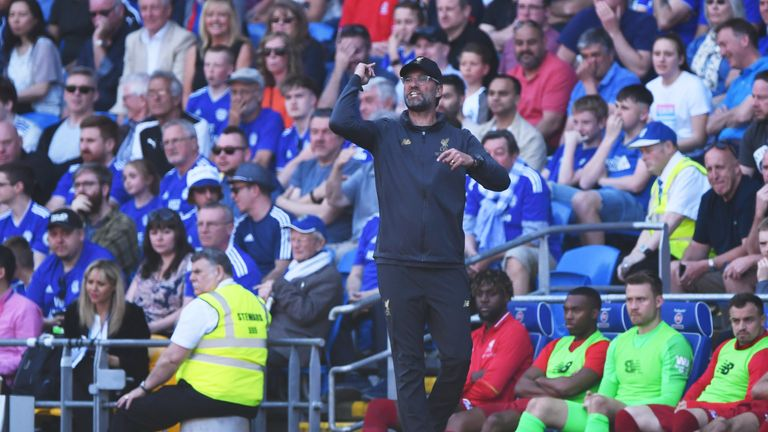 Jurgen Klopp gestures on the sideline during Liverpool's win at Cardiff.