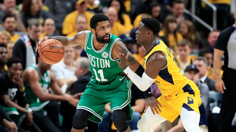 Kyrie Irving of the Boston Celtics dribbles the ball against the Indiana Pacers in game four of the first round of the 2019 NBA Playoffs