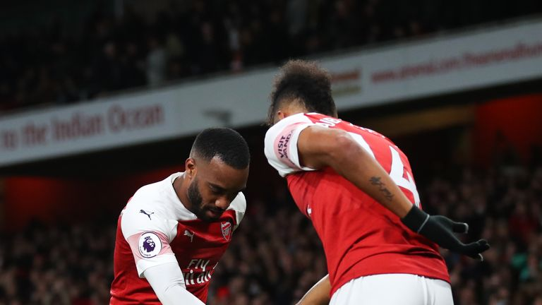 Alexandre Lacazette celebrates with Pierre-Emerick Aubameyang