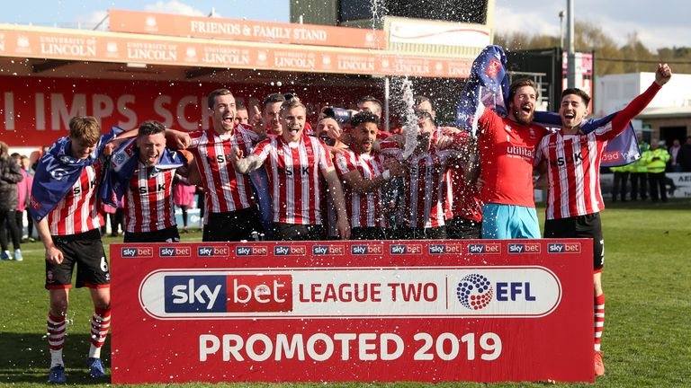Lincoln celebrate winning promotion from Sky Bet League Two