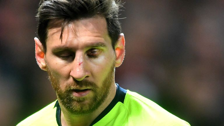 Lionel Messi was left bloodied and bruised by Chris Smalling