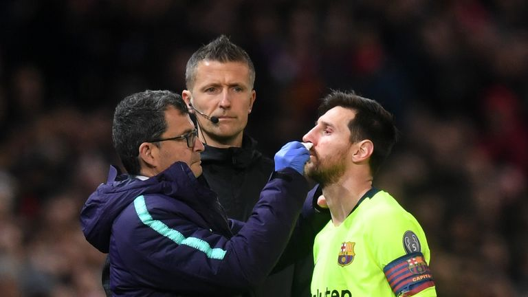 Lionel Messi received treatment to a facial injury after clashing with Chris Smalling in the first leg