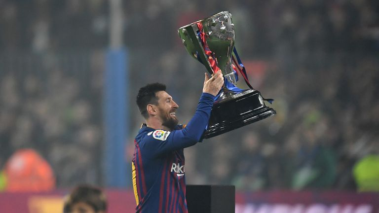 Messi lifts the La Liga trophy for Barcelona