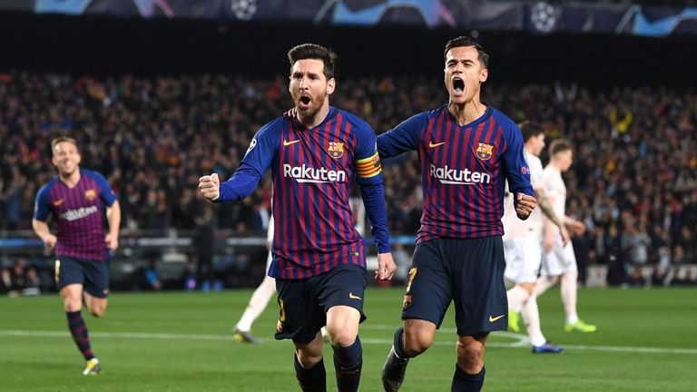 Lionel Messi celebrates scoring his first goal against Manchester United with Barcelona team-mate Philippe Coutinho