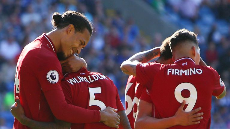 Virgil van Dijk congratulates Gini Wijnaldum after his opening goal for Liverpool against Cardiff