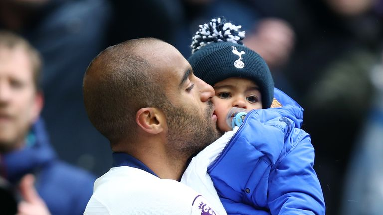 Lucas Moura celebrates with his son Miguel at full-time