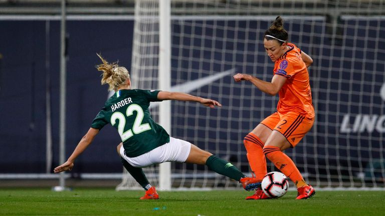 Pernille Harder of Wolfsburg challenges Lucy Bronze of Lyon during the UEFA Women's Champions League: Quarter Final Second Leg match between Wolfsburg and Lyon at AOK Stadion on March 27, 2019 in Wolfsburg, Germany.